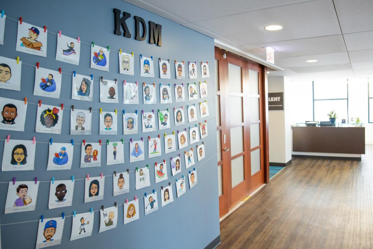 Employee bitmoji wall at KDM's headquarters in Chicago.